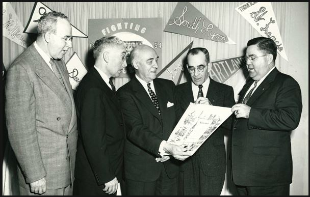 "U.S. Rep Louis Rabaut (D-Mich) presents a scroll with the words ""under God"" to KofC Michigan State Deputy Walter Graveline"